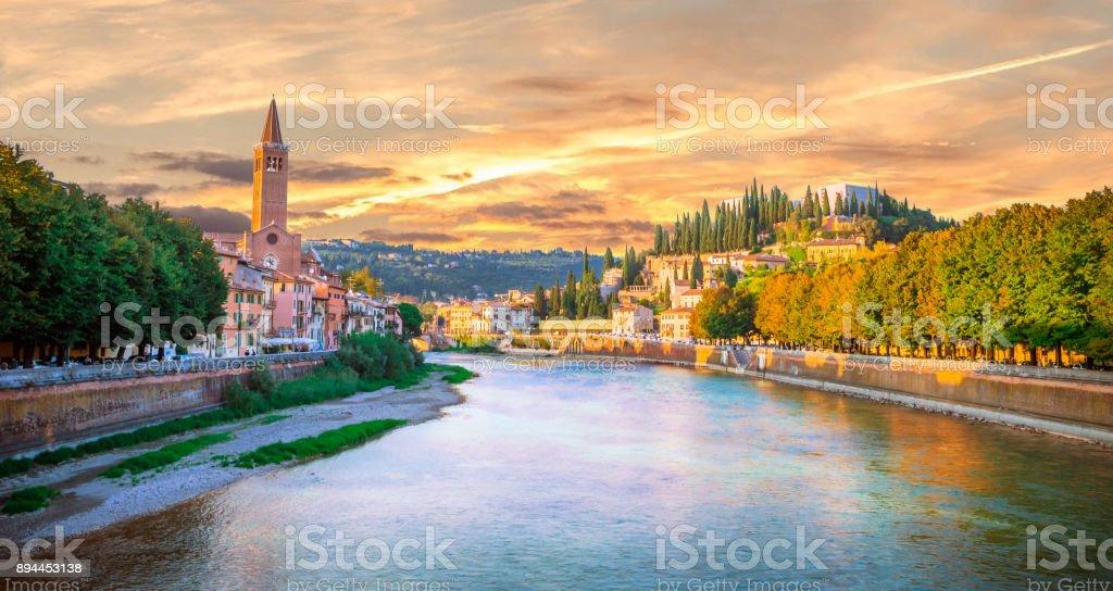 Beautiful old houses and Teatro Romano on Adige river in Verona at sunset, Veneto region, Italy. stock photo