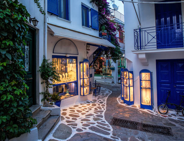Beautiful old, narrow alley with cobblestone in Skiathos, Greece stock photo