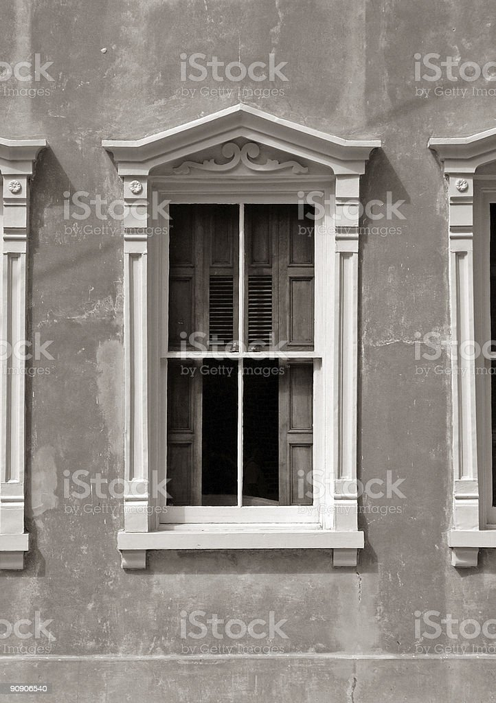 beautiful old window in a small Southern town sepia toned royalty-free stock photo