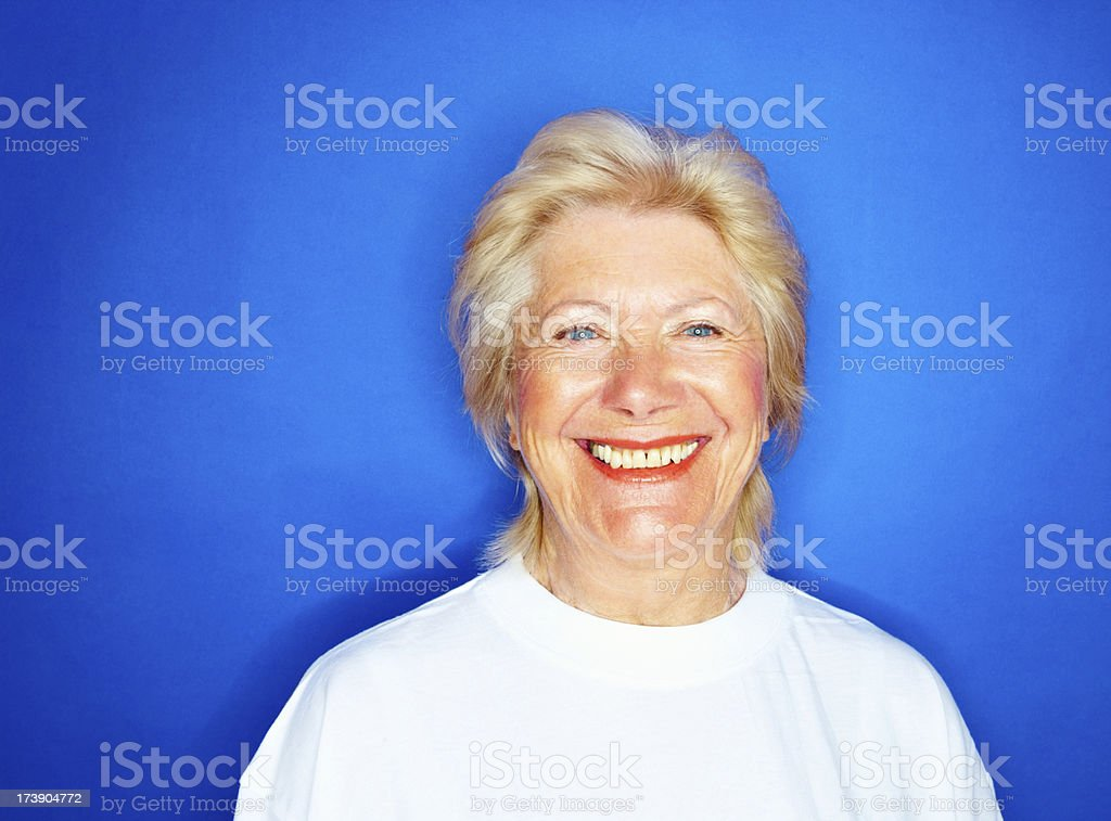 Beautiful old woman isolated against blue royalty-free stock photo