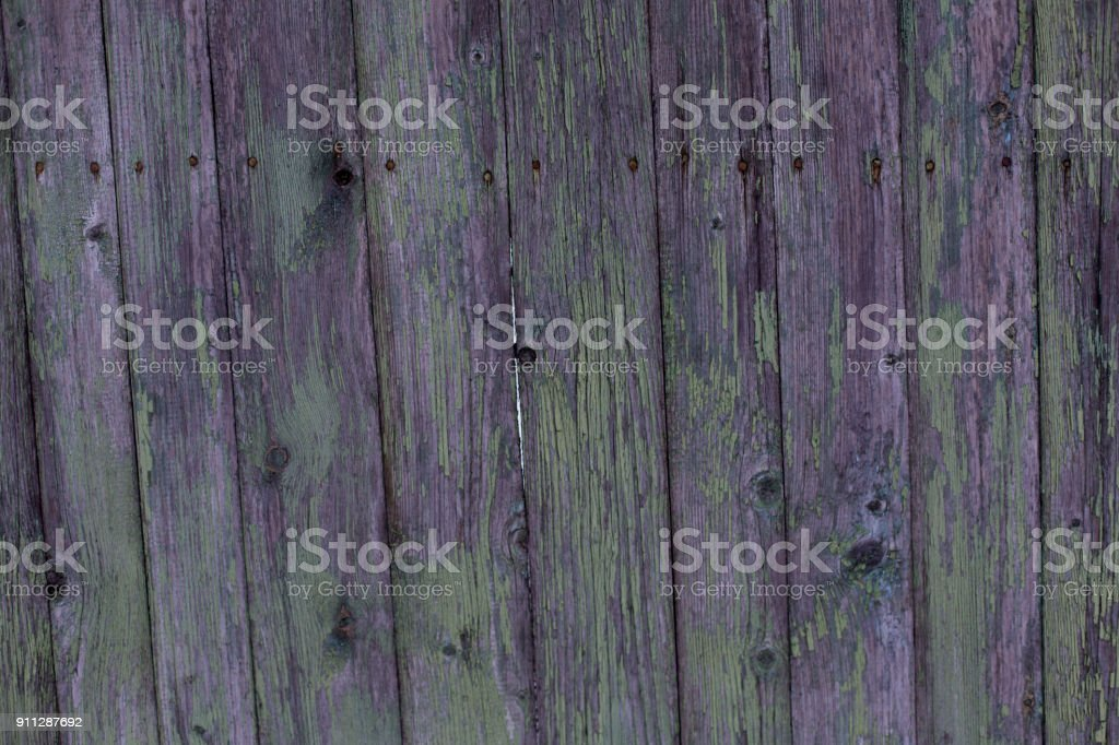 Beautiful old wooden fence with peeling paint texture background royalty-free stock photo