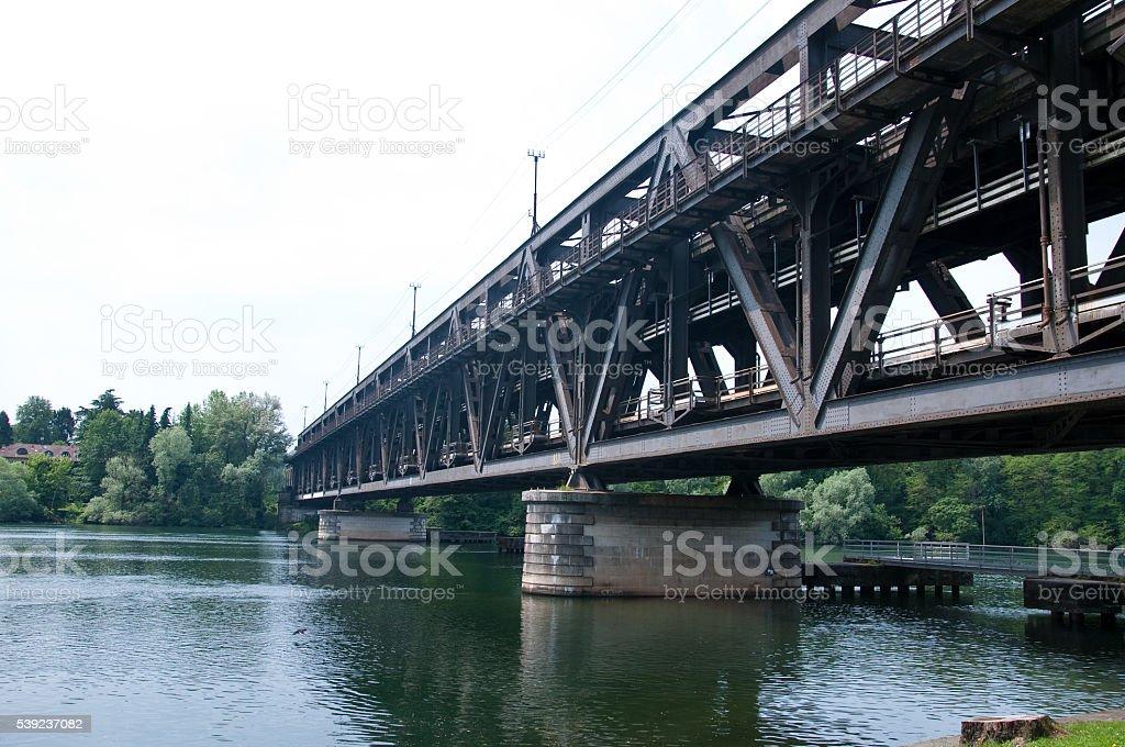 beautiful old wrought iron bridge on Ticino river royalty-free stock photo
