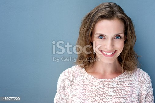 istock Beautiful older woman smiling with sweater 469077200