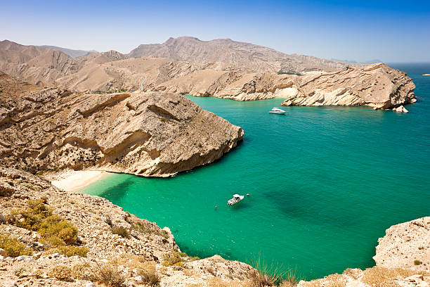 Beautiful Oman Coast Green Lagoon with Hidden Beach stock photo