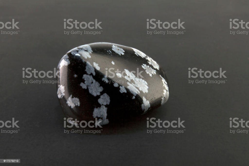 Beautiful one stone snowflake obsidian volcanic glass stock photo