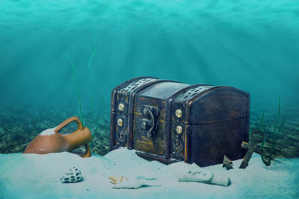 beautiful opened empty old wooden treasure chest submerged under beautiful opened empty old wooden treasure chest submerged underwater world with anchor, amphora and light rays, close up sunken stock pictures, royalty-free photos & images