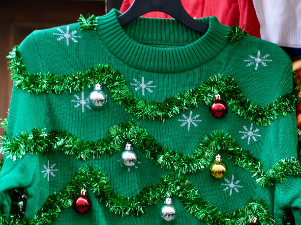 Beautiful or ugly: green Christmas sweater with decor balls Look for it in Christmas markets in Vienna ugliness stock pictures, royalty-free photos & images