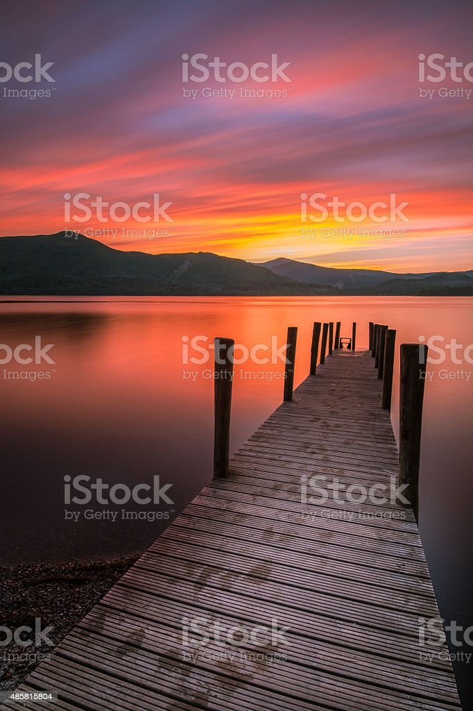 Beautiful Orange Sunset With Jetty In English Lake District. stock photo