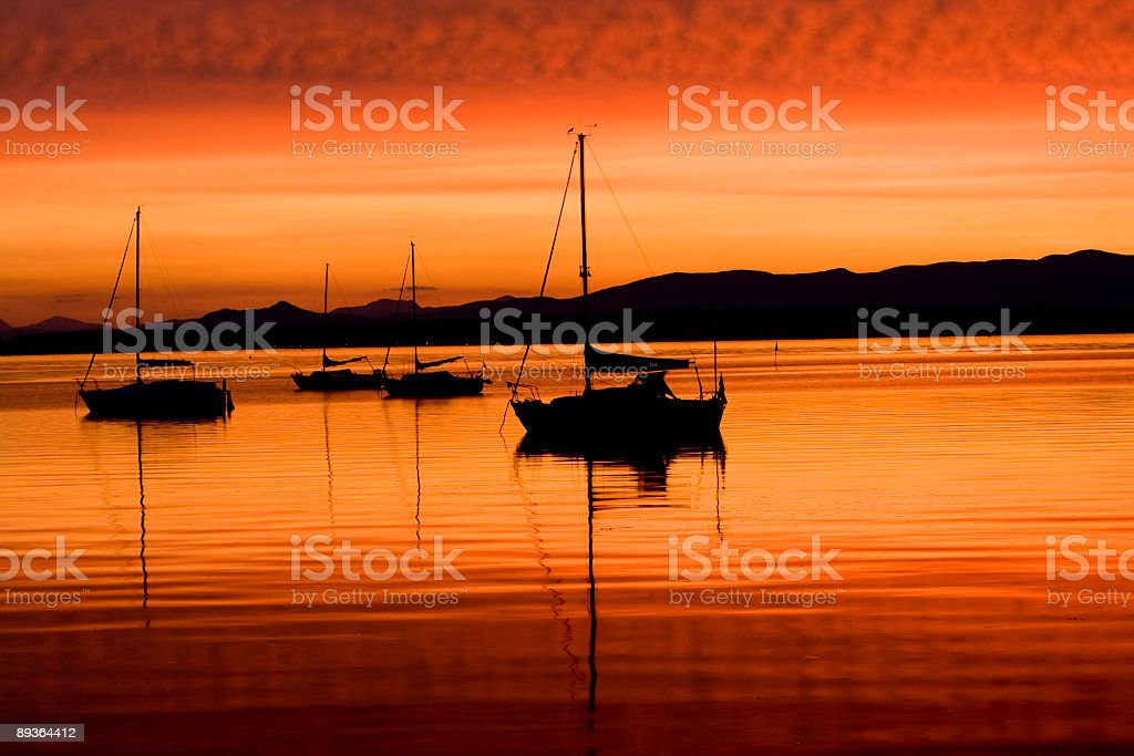 Beautiful orange sunset with sailboats in silhouette. royalty-free stock photo