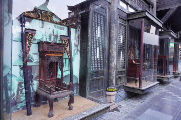 beautiful oriental wooden made antique chair displaying at the side of wide narrow street. - curator stock pictures, royalty-free photos & images