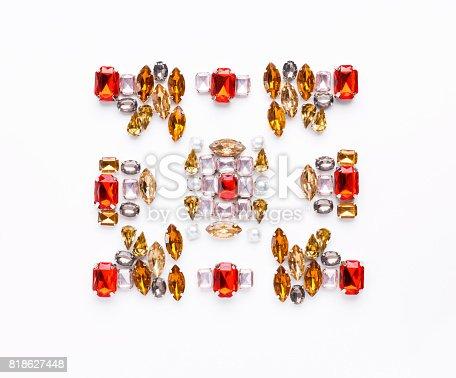 istock Beautiful ornament of gemstone on white background 818627448