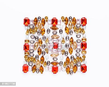 istock Beautiful ornament of gemstone on white background 818627736