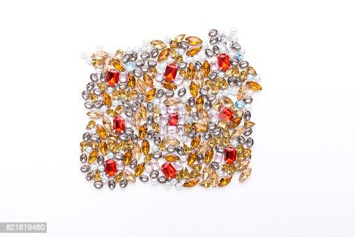 istock Beautiful ornament of gemstone on white background 821819480