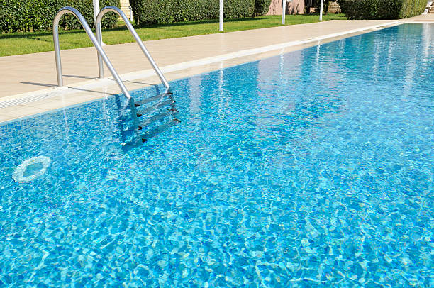 Beautiful Outdoor Hotel Swimming Pool in Sunshine stock photo