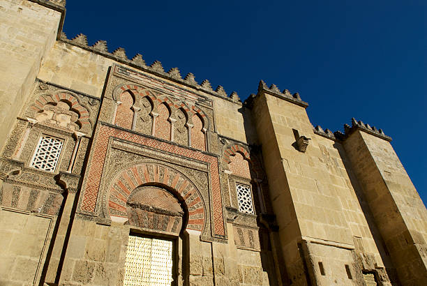 Beautiful Mezquita Exterior Fortified wall of La Mezquita Cathedral in Córdoba, Andalusia, Spain. Exterior architecture taken from outside the compound. cordoba mosque stock pictures, royalty-free photos & images