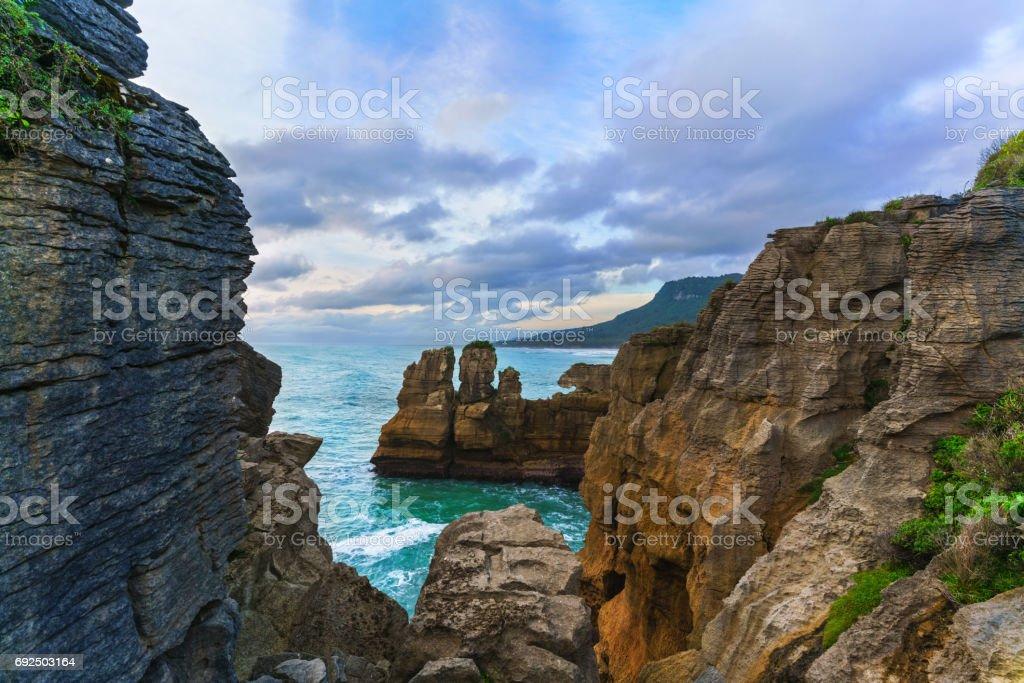 Beautiful Pancake Rocks and Blowholes are located in Paparoa National Park , Punakaiki , South Island of New Zealand stock photo