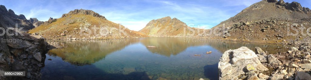 A beautiful panorama of an alpine lake at an altitude of 2,800 meters above sea level in an archipelago stock photo