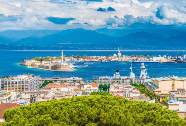 Beautiful panorama of Messina port with blue mountains in the background. It is written on the seawall in Latin