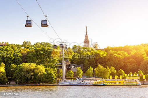Beautiful panorama of Moscow in sun light, Russia. Scenic view of the cable car between Sparrow Hills and Luzhniki Stadium in Moscow. Cableway cabins hang over Moskva River at Moscow Luzhniki park.
