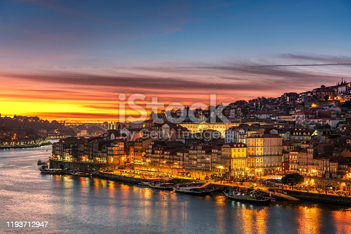 View to Porto over river Douro with reflection of the lights at sunset