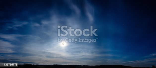 istock Beautiful panorama of the full moon that has gone over the Carpathians 1133765778