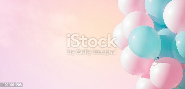 istock Beautiful panoramic background with pink and blue balloons 1004961296