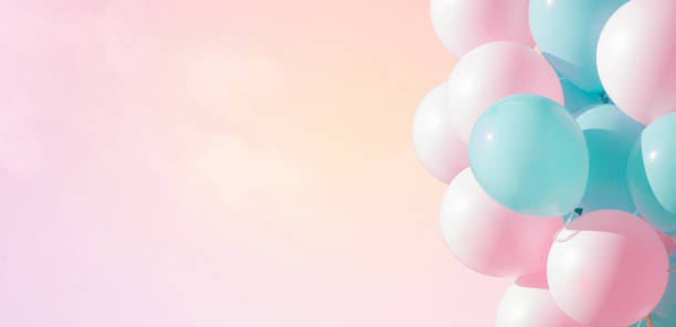 Beautiful panoramic background with pink and blue balloons Beautiful panoramic background with pink and blue balloons. Group of pastel party balloons on soft background. Concept of happiness, joy, birthday. Wide Angle Holiday Web Banner With Copy Space pastel colored stock pictures, royalty-free photos & images