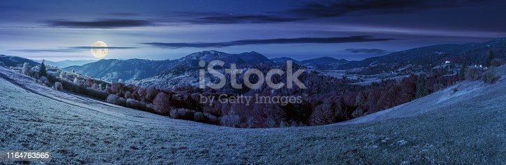 1074120624 istock photo beautiful panoramic landscape in october at night 1164763565