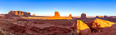 Beautiful panoramic sunset view over famous Buttes of Monument Valley on the border between Arizona and Utah, USA