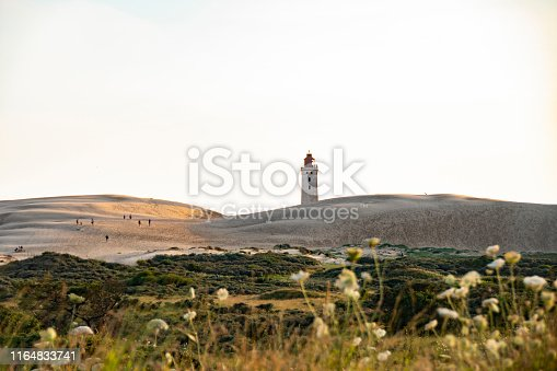 Beautiful panoramic view of Scandinavian sand dunes and lighthouse located in the west coast of Denmark