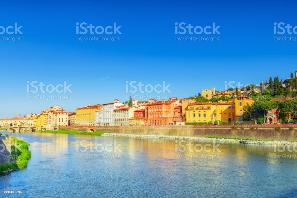 Beautiful panoramic view of the Arno River and the town of Renaissance Italy - Florence. stock photo