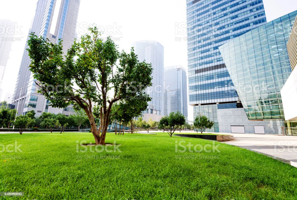 Beautiful park and modern buildings stock photo