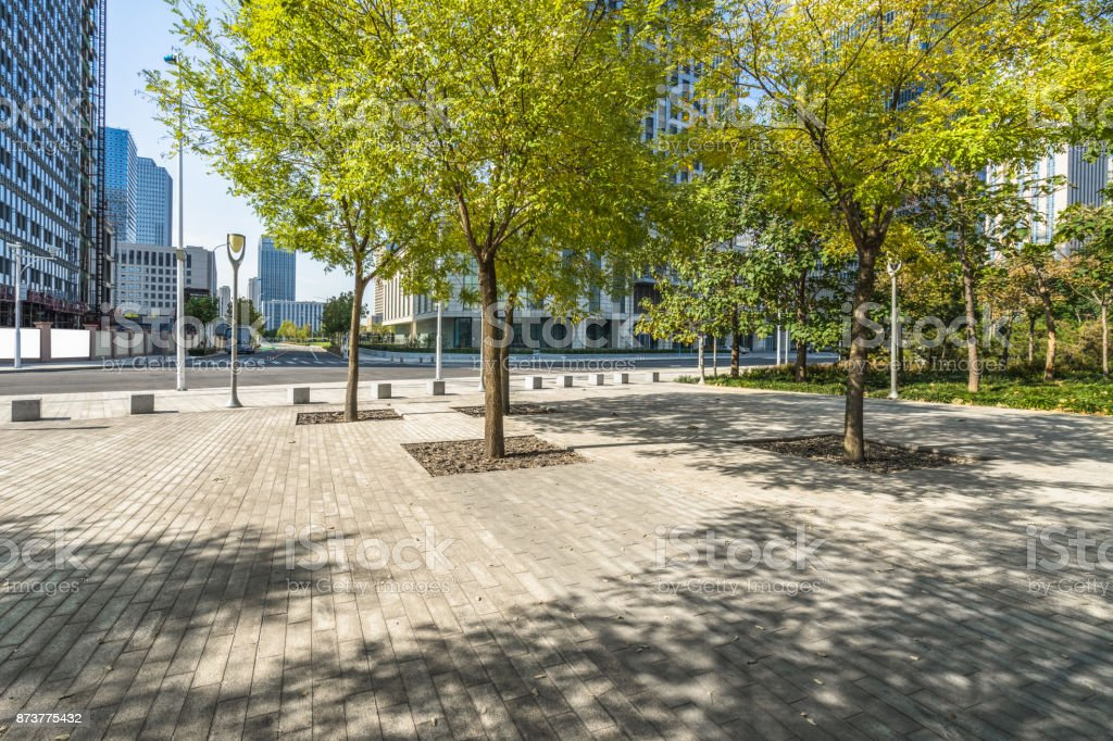 beautiful park front of the modern office building at a sunny day, china. royalty-free stock photo