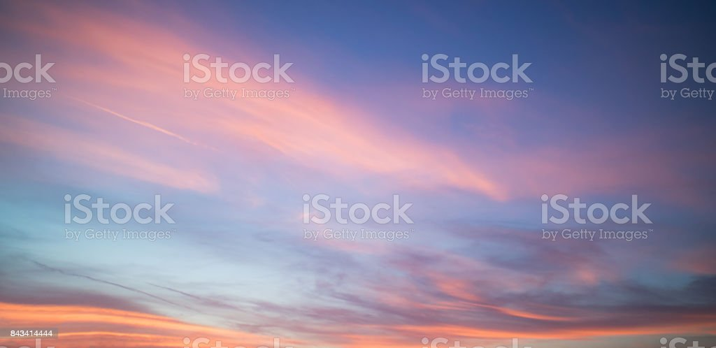 Beautiful pastel cloudy sunset with blue sky in California stock photo