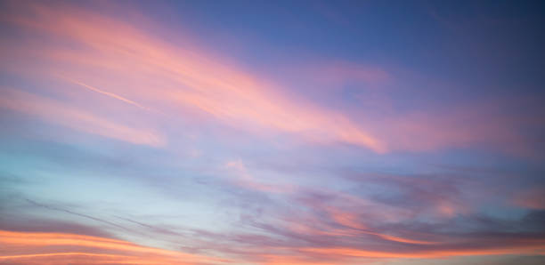 beautiful pastel cloudy sunset with blue sky in california - skies stock photos and pictures
