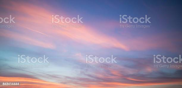 Photo of Beautiful pastel cloudy sunset with blue sky in California