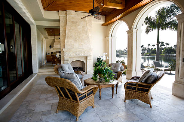 beautiful patio furniture at estate home overlooking bay - hawaii home stock photos and pictures