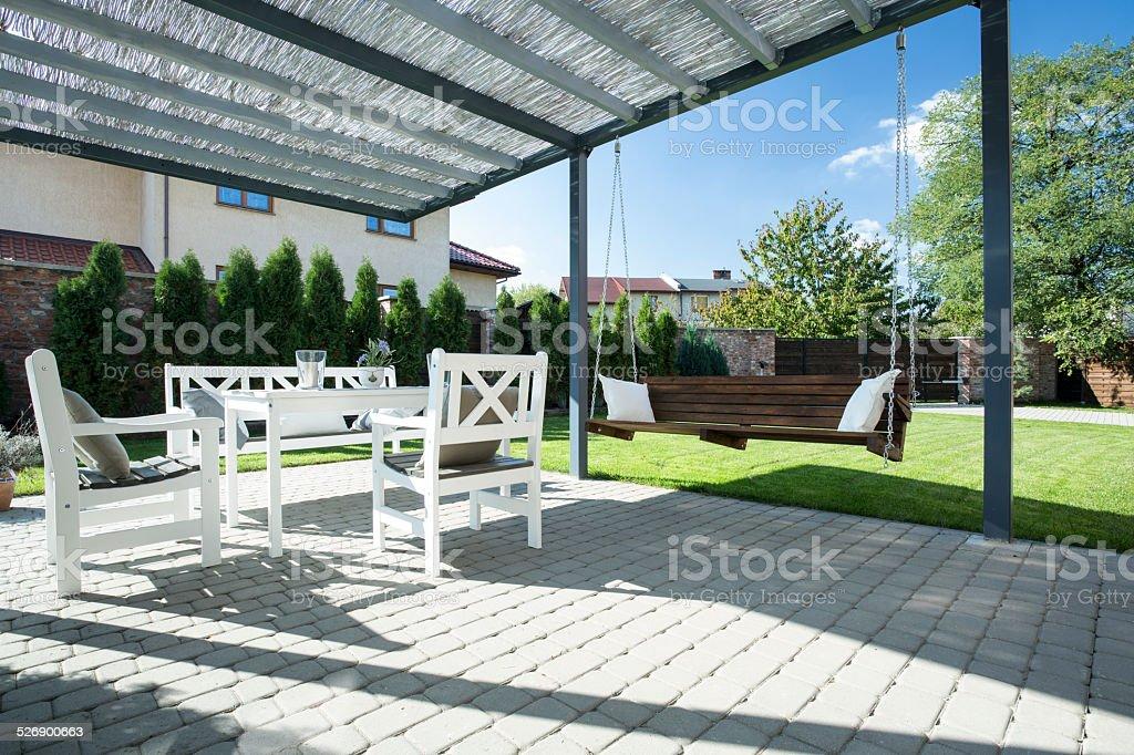 Beautiful patio with swing stock photo