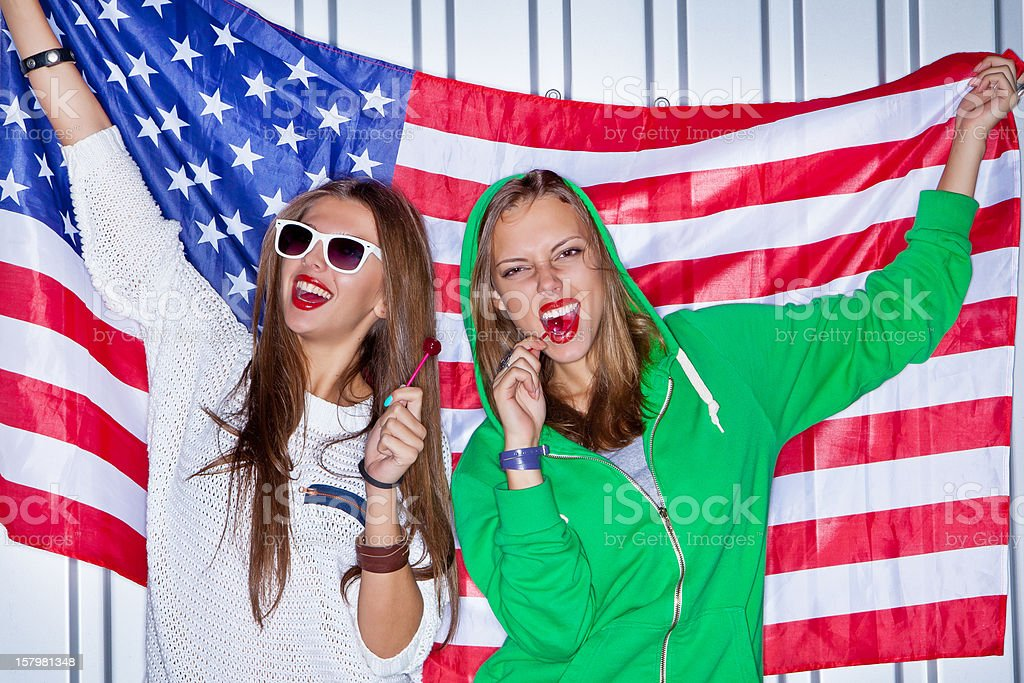 Beautiful patriotic girls with lollipop stock photo