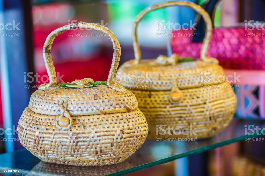 Beautiful pattern of weaved dried water hyacinth lady handbag for sale on the walking street market in Bangkok, Thailand. royalty-free stock photo