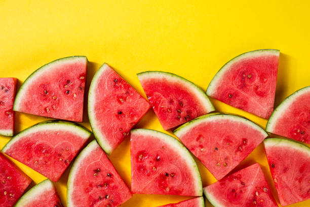 beautiful pattern with fresh watermelon slices on yellow bright background. top view. - summer background стоковые фото и изображения