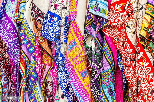 Beautiful patterned on the Thai style garment, batik and clothing for sale at the local market.