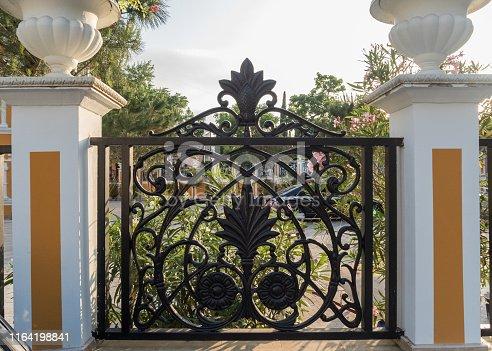 Beautiful patterns on the iron fence. Park Riviera.
