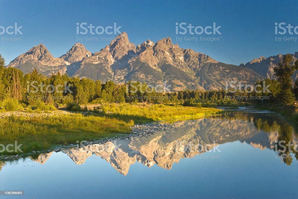 Beautiful peaceful lake and mountains in Grand Tetons stock photo