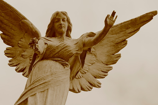 Beautiful peaceful Madonna Angel offering hope, Recoleta cemetery, Buenos Aires