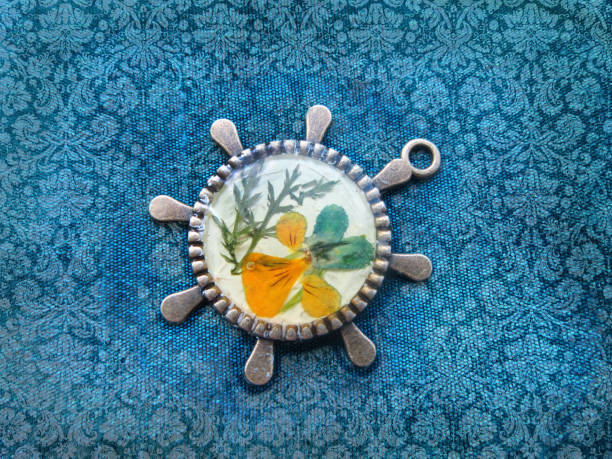 Beautiful pendant with flowers in resin. Women's jewelry, Beautiful pendant with flowers in resin. Women's jewelry, accessory. fossilized pitch stock pictures, royalty-free photos & images