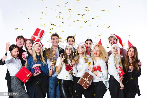 627933752istockphoto Beautiful people having fun on a white background. Concept celebrating New Year or Christmas. 886032222