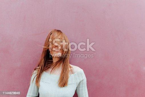 istock Beautiful People on pink wall 1144629945