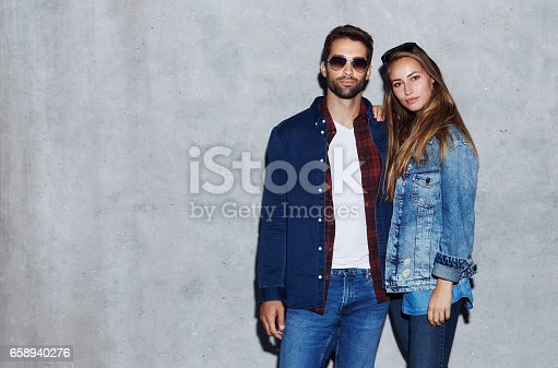 Beautiful people in studio in jeans and jacket, portrait