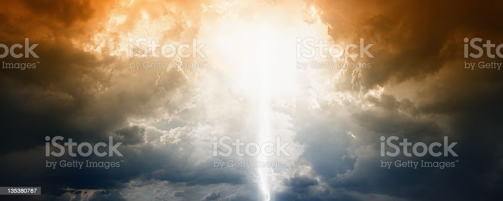 A beautiful photograph of the sun shining through the clouds stock photo